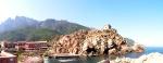 Panorama su cui svetta la torre Genovese di Portu